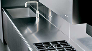 Stainless steel kitchen equipment and surfaces